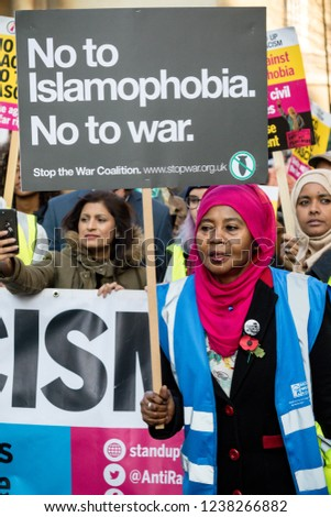 London, United Kingdom, November 17th 2018:- Stop the war activist at the Stand Up To Racism march through central London from the BBC to near Downing Street in Whitehall