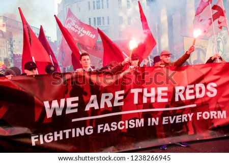London, United Kingdom, November 17th 2018:- Reds setting off flares at the Stand Up To Racism march through central London from the BBC to near Downing Street in Whitehall