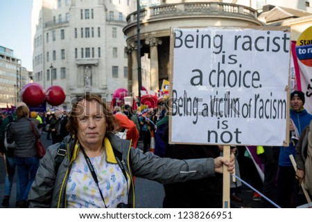 London, United Kingdom, November 17th 2018:- Anti racist proteser at the Stand Up To Racism march through central London from the BBC to near Downing Street in Whitehall