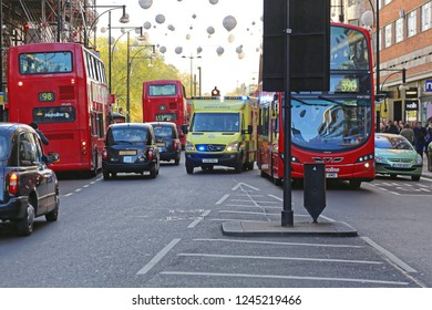 London, United Kingdom - November 23, 2013: Ambulance Emergency Van at Oxford StreetTraffic in London, UK.
