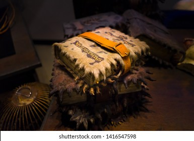 London / United Kingdom - November 23 2017: Warner Bros Harry Potter Studio. The Monster Book of Monsters, vicious sentient textbook used in Care of Magical Creatures while Rubeus Hagrid.