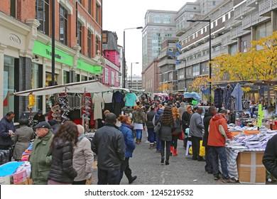 London, United Kingdom - November 24, 2013: Shoppers at Petticoat Lane Market With Clothing Stalls at Sunday in London, UK.