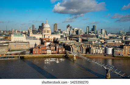 London, United Kingdom, November 30 2018: Cityscape of the city of London with people walking at the famous millennium bridge and view of the St. Pauls cathedral.