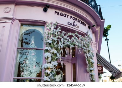 LONDON, UNITED KINGDOM - NOVEMBER 30th, 2018: Stylish cake shop  in upmarket Chelsea are is decorated for Christmas