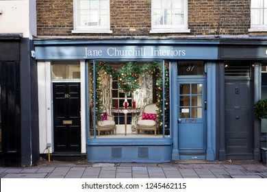 LONDON, UNITED KINGDOM - NOVEMBER 30th, 2018: Traditional store fronts in stylish Chelsea are in Central London is decorated with Christmas ornaments