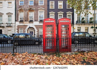 LONDON, UNITED KINGDOM - NOVEMBER 30th, 2018: Traditional telephone booths on Berkeley Square in Mayfair