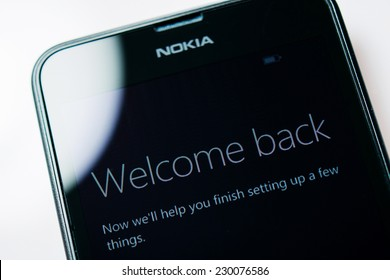 LONDON, UNITED KINGDOM - NOVEMBER 9, 2014: Nokia Lumia Windowsphone smartphone display with Welcome Back text. Microsoft has announced that it will stop using Nokia branding