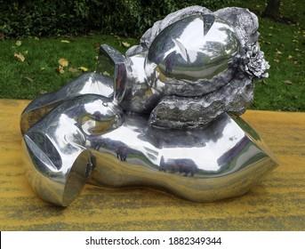 LONDON, UNITED KINGDOM - Oct 18, 2014: Thomas Schutte's sculpture Aluminiumfrau at the Frieze Art exhibition in Regents Park, London