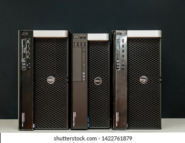 London, United Kingdom - Oct 2, 2017: Front view of three new Dell Precision T3610 7910 Xeon workstation for heavy computing AI calculations