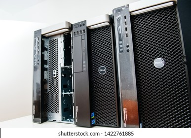 London, United Kingdom - Oct 2, 2017: Row of three new Dell Precision T5810 7910 Xeon workstation for heavy computing AI calculations - once computer is with the open front door for eight HDD