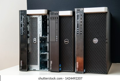 London, United Kingdom - Oct 2, 2017: Row of new Dell Precision T5810 7910 Xeon workstation for heavy computing AI calculations with one of it having open door for HDD disk drives