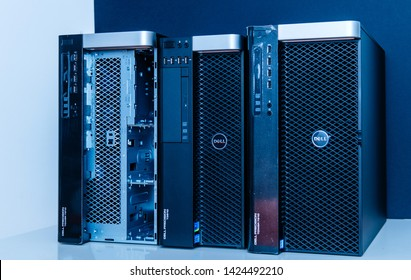 London, United Kingdom - Oct 2, 2017: Row of new Dell Precision T3610 T7910 Xeon workstation for heavy computing AI calculations blue color cast on of the workstation has open the front door for HDD