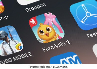 London, United Kingdom - October 01, 2018: Close-up shot of the FarmVille 2: Country Escape application icon from Zynga Inc. on an iPhone.