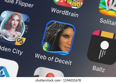 London, United Kingdom - October 01, 2018: The Web of Deceit: Deadly Sands - A Hidden Objects Adventure mobile app from Big Fish Games, Inc on an iPhone screen.