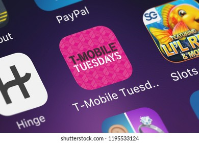London, United Kingdom - October 01, 2018: Close-up shot of the T-Mobile Tuesdays application icon from T-Mobile on an iPhone.