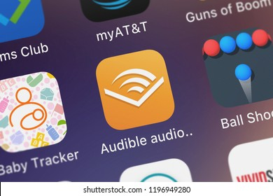 London, United Kingdom - October 01, 2018: Icon of the mobile app Audible audio books  podcasts from Audible, Inc. on an iPhone.