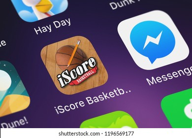 London, United Kingdom - October 05, 2018: Icon of the mobile app iScore Basketball Scorekeeper from Sports Illustrated Play LLC on an iPhone.