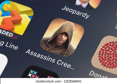 London, United Kingdom - October 05, 2018: Close-up shot of the Assassin's Creed Identity application icon from Ubisoft on an iPhone.