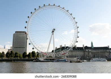 LONDON, UNITED KINGDOM - OCTOBER 10, 2012: Depiction of the London Eye Ferris Wheel on the banks of Thames River