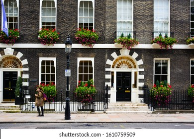 London / United Kingdom — October 18, 2019: facades of Georgian era houses in Bedford Square in Bloomsbury, London. These stylish facades with flower pots are often considered traditional British
