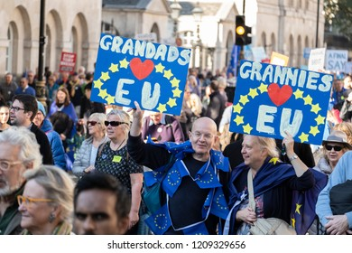 LONDON, UNITED KINGDOM - OCTOBER 20, 2018: People's Vote March, demanding a second referendum on Brexit. Two people holding up placards saying Grandads and Grannies 'love' the EU.
