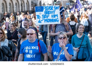 LONDON, UNITED KINGDOM - OCTOBER 20, 2018: People's Vote March, demanding a second referendum on Brexit. Woman blowing a whistle and with banner: 'Please stop Brexit to stop him moaning.'