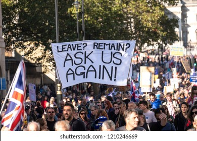"""LONDON, UNITED KINGDOM - OCTOBER 20, 2018: People's Vote March, demanding a second referendum on Brexit. Banner with words: 'Leave? Remain"""" Ask us again!'"""