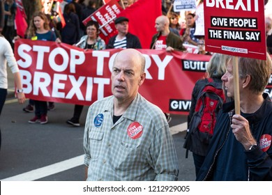 LONDON, UNITED KINGDOM - OCTOBER 20, 2018: People's Vote March, demanding a second referendum on Brexit. Man with sticker reading, 'Love Corbyn, Hate Brexit' in front of 'Stop Tory Brexit' banner.