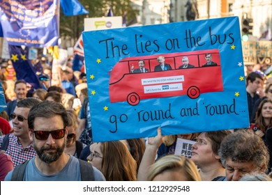 LONDON, UNITED KINGDOM - OCTOBER 20, 2018: People's Vote March, demanding a second referendum on Brexit. Woman holding banner reading 'The lies on the bus go round and round' referring to the NHS.