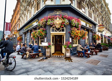 LONDON, UNITED KINGDOM - October 2019: Old traditional Pub , Brewery, Bar entrance decorated with flowers in Central London, United Kingdom