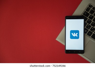 London, United Kingdom, October 23, 2017: Vkontakte logo on smartphone screen placed on laptop keyboard. Empty place to write information with red background.