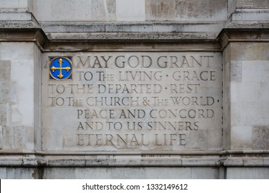 "London, United Kingdom, October 3 2013: Inscription ""May God Grant ..."" at the West Facade of Westminster Abbey"
