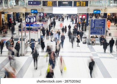 London, United Kingdom - OCTOBER 30, 2014: Liverpool Street Station, one of the busiest station in London, in rush hour in front of arrival departure board.