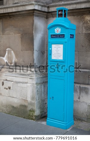 London, United Kingdom - October 30th, 2017:- Old police phone box near the Guildhall of the City of London