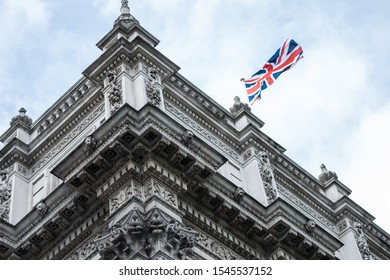 LONDON, UNITED KINGDOM - OCTOBER 4, 2019: Building with UK flag on 10th Downing Street