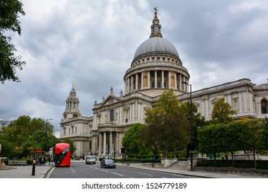 London / United Kingdom — October 5, 2019: the majestic St Paul's Cathedral, located in the City of London, with its large dome, seen from the St Paul's Churchyard street on a cloudy day