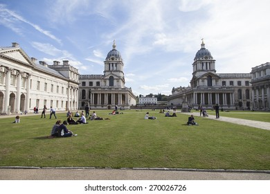 London, United Kingdom - October 5, 2014: Old Royal Naval College in Greenwich and visitors in front of it.