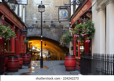 LONDON, UNITED KINGDOM - OCTOBER 7, 2014:  Quaint arched pedestrian walkway at Charing Cross in London, England.