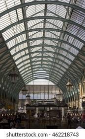 LONDON, UNITED KINGDOM - SEPTEMBER 12 2015: People in Covent Market covered roof in London, United Kingdom