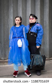 LONDON, United Kingdom- SEPTEMBER 14 2018: People on the street during the London Fashion Week. Fashion blogger Sinyu Siu from China