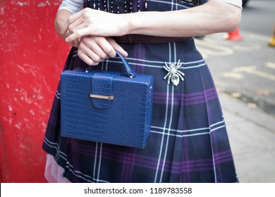 LONDON, United Kingdom- SEPTEMBER 14 2018: People on the street during the London Fashion Week. Blue bag