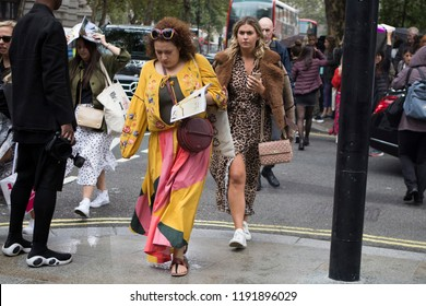 LONDON, United Kingdom- SEPTEMBER 14 2018: People on the street during the London Fashion Week. A crowd of fashionably dressed people hurry to work at rush hour on Strand Street