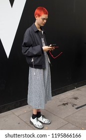 LONDON, United Kingdom- SEPTEMBER 14 2018: People on the street during the London Fashion Week. Redhead short-haired girl model in a black bomber jacket . Anna Rubin is a model