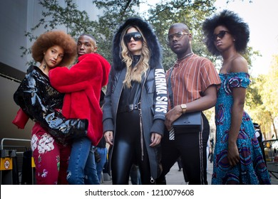 LONDON, United Kingdom- SEPTEMBER 14 2018: People on the street during the London Fashion Week. A group of fashionably dressed friends chatting at the entrance to the building