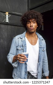 LONDON, United Kingdom- SEPTEMBER 14 2018: People on the street during the London Fashion Week. Curly man in denim shirt