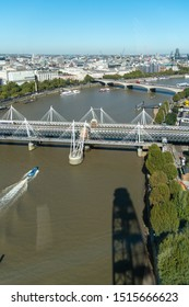 London, United Kingdom - September 21 2019: Hungerford, Jubilee and Waterloo bridges crossing the River Thames against a blue sky