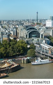London, United Kingdom - September 21 2019: Charing Cross Station against a blue sky with Hungerford and Jubilee Bridges crossing the River Thames