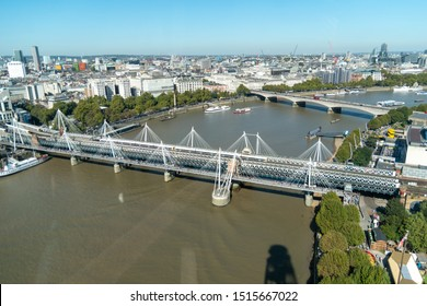 London, United Kingdom - September 21 2019: Hungerford and Jubilee bridges crossing the River Thames against a blue sky