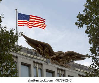 London, United Kingdom - September 23, 2016: The American Flag. The American flag on the embassy in London catches the evening sunset making it glow.
