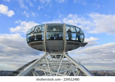 London, United Kingdom - September 26: Tourists look out from a pod as the London Eye reaches its zenith on September 26, 2014 in London, UK.